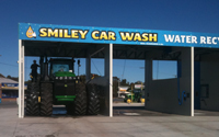 Tractor going through the smiley car wash